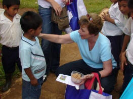 Sherry presenting a gift to a Guaymi boy